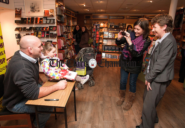 "131012.2 year old Lauren Reidy from Clarecastle poses for pictures with John ""The Bull"" Hayes during a book singing at Ennis Bookstore."
