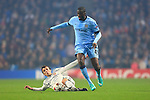 Roman Eremenko of CSKA tackles Yaya Toure of Manchester City - Manchester City vs. CSKA Moscow - UEFA Champions League - Etihad Stadium - Manchester - 05/11/2014 Pic Philip Oldham/Sportimage