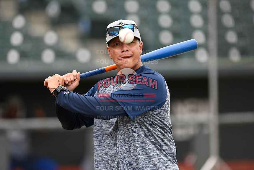 Manager Pedro Lopez (16) of the Columbia Fireflies hits fungos before a game against the Charleston RiverDogs on Friday, April 5, 2019, at Segra Park in Columbia, South Carolina. Charleston won, 6-1. (Tom Priddy/Four Seam Images)