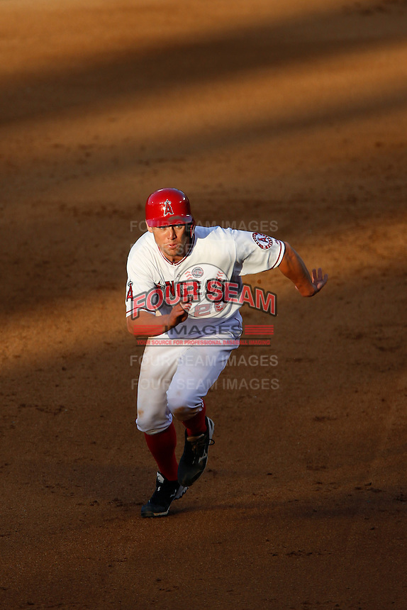 Peter Bourjos #25 of the Los Angeles Angels runs the bases during a game against the New York Yankees at Angel Stadium on June 15, 2013 in Anaheim, California. (Larry Goren/Four Seam Images)