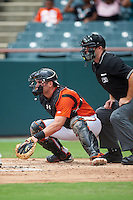 Bowie Baysox catcher Austin Wynns (18) and umpire Brian Peterson await the pitch during the first game of a doubleheader against the Akron RubberDucks on June 5, 2016 at Prince George's Stadium in Bowie, Maryland.  Bowie defeated Akron 6-0.  (Mike Janes/Four Seam Images)
