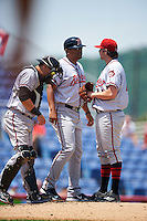 Richmond Flying Squirrels manager Miguel Ojeda (35) talks with pitcher Andrew Suarez (41) as catcher Eliezer Zambrano (2) listens in during a game against the Binghamton Mets on June 26, 2016 at NYSEG Stadium in Binghamton, New York.  Binghamton defeated Richmond 7-2.  (Mike Janes/Four Seam Images)