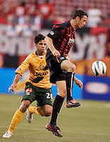 The MetroStars' Mark Lisi looks to steady the ball in front of the Galaxy's Marcelo Saragosa. The NY/NJ MetroStars defeated the LA Galaxy 3 to 0 during MLS action at Giant's Stadium, East Rutherford, NJ, on August 8, 2004.