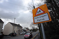 "Pictured: A bilingual ""Patrol"" sign on the B4297 Pontardulais Road, in Llangennech, west Wales. Thursday 24 February 2017<br />