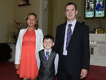 Joe Smith who received first holy communion in St Michael's church Clogherhead pictured with parents Paul and Patricia. Photo:Colin Bell/pressphotos.ie