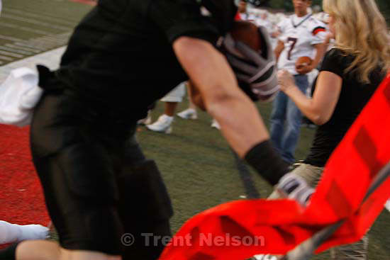 Sandy - Alta vs. Timpview high school football Friday, September 4 2009. .Alta's Zach Liston runs into the sideline crowd.