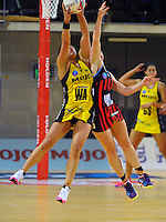 Liana Leota takes a pass under pressure from Chloe Williamson during the ANZ Netball Championship match between the Central Pulse and Mainland Tactix at Te Rauparaha Arena, Wellington, New Zealand on Saturday, 11 May 2015. Photo: Dave Lintott / lintottphoto.co.nz