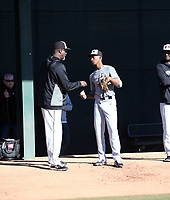 Markevian Hence (right) receives instruction from pitching coach Marvin Freeman at the 2020 MLB Dream Series on January 19, 2020 at the Los Angeles Angels training complex in Tempe, Arizona (Bill Mitchell)