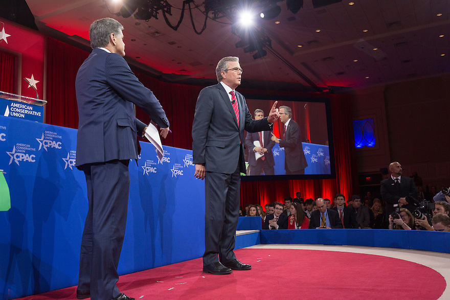 Former Florida Governor Jeb Bush is interviewed by Fox News' Sean Hannity at the 2015 Conservative Political Action Conference (CPAC) outside Washington, DC