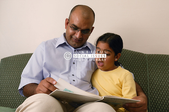 Father reading to his daughter,
