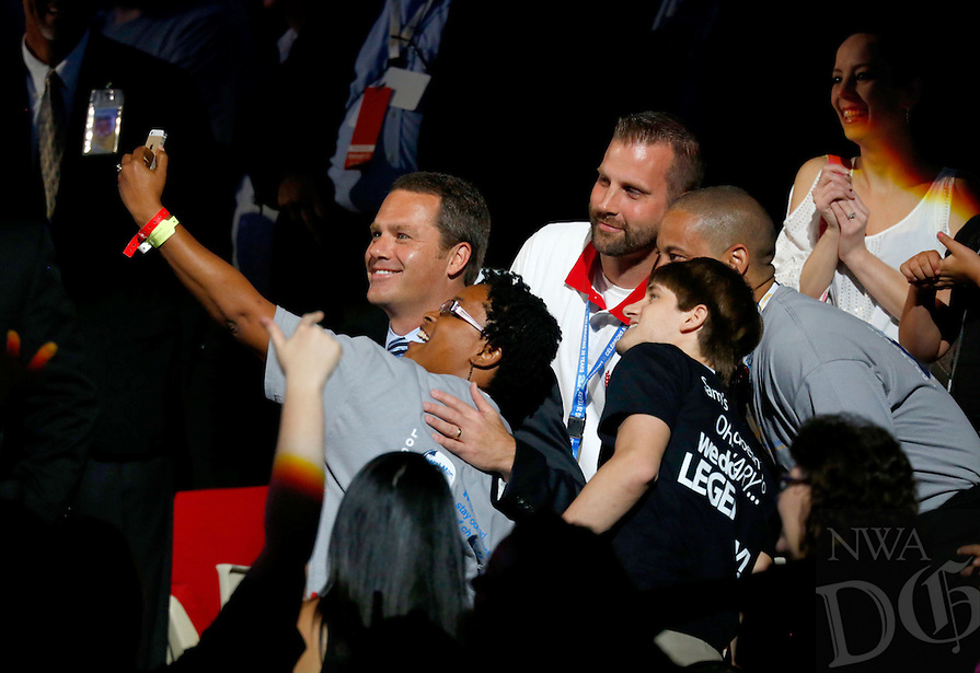STAFF PHOTO JASON IVESTER --06/06/2014--<br /> Doug McMillon, Walmart chief executive officer, takes a selfie with employees in the crowd on Friday, June 6, 2014, during the annual Shareholders Meeting inside Bud Walton Arena in Fayetteville.