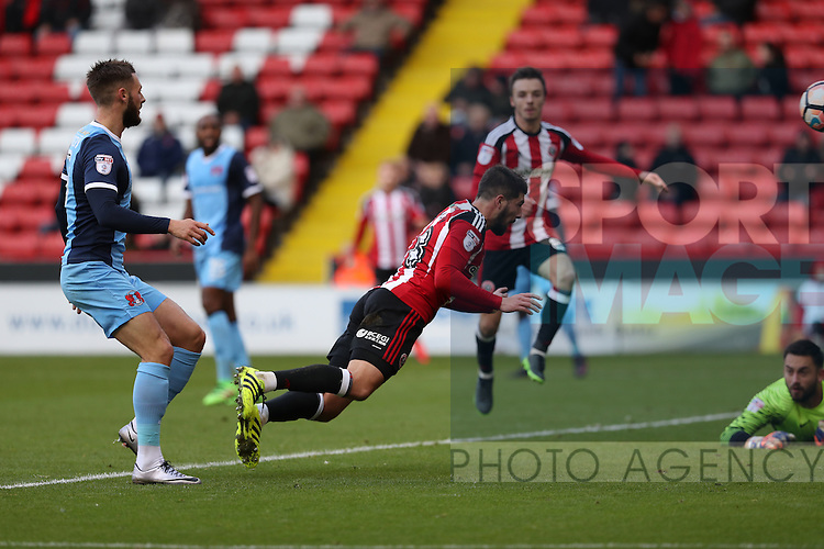 Kieron Freeman of Sheffield United scoring his team third goal of the game with his head during the Emirates FA Cup Round One match at Bramall Lane Stadium, Sheffield. Picture date: November 6th, 2016. Pic Simon Bellis/Sportimage