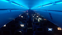 """Redeye Flight in Blue"" by Art Harman. Somewhere over America on a transcontinental flight, as passengers slumbered and the deep blue cabin lights added an ethereal glow at 500 mph."