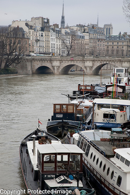 Ile de la Cite and the River Seine with Barges in Paris, France