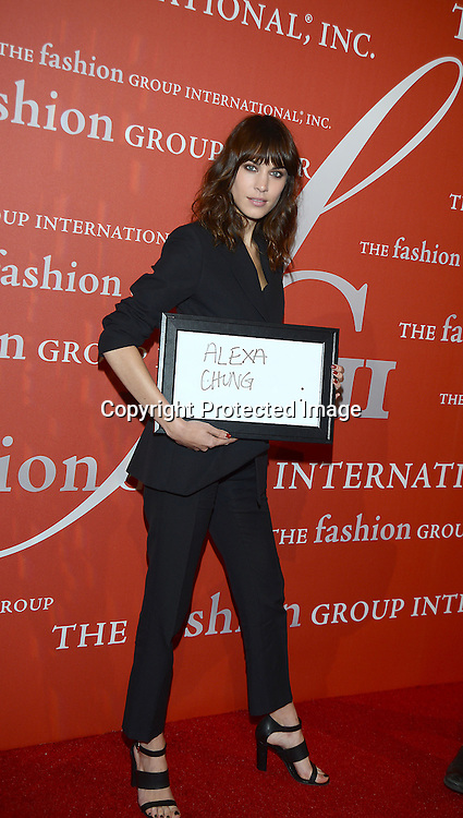 Alexa Chung in Christopher Kane suit attends the Fashion Group International's Night of Stars Gala on October 22, 2013 at Cipriani Wall Street in New York City.