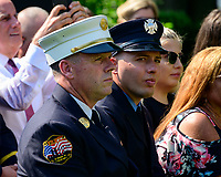 Former fire chief of the Midtown Manhattan firehouse Chief John Joyce, left, and New York City firefighter Terrance Pfeifer, right, look on as United States President Donald J. Trump makes remarks prior to signing H.R. 1327, an act to permanently authorize the September 11th victim compensation fund, in the Rose Garden of the White House in Washington, dC on Monday, July 29, 2019. <br /> Credit: Ron Sachs / Pool via CNP/AdMedia