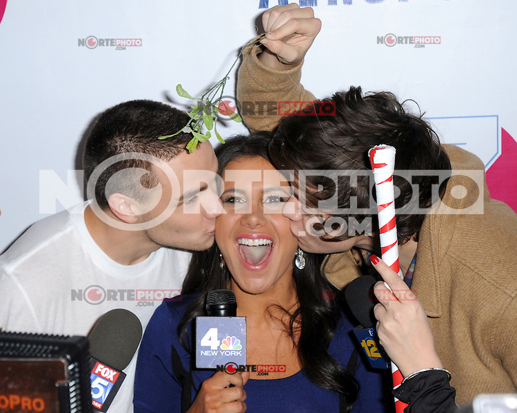 New York, NY- December 7, 2012:  Liam Payne and Harry Styles of One Direction give a kiss to Joelle Garguilo of NBC on the red carpet during Z100 Jingle Ball 2012 , presented by Aeropostale on December 7, 2012 at Madison Square Garden in New York City. (C) Joe Stevens/ Retna Ltd. / Mediapunchinc /NortePhoto /NortePhoto© /NortePhoto /NortePhoto