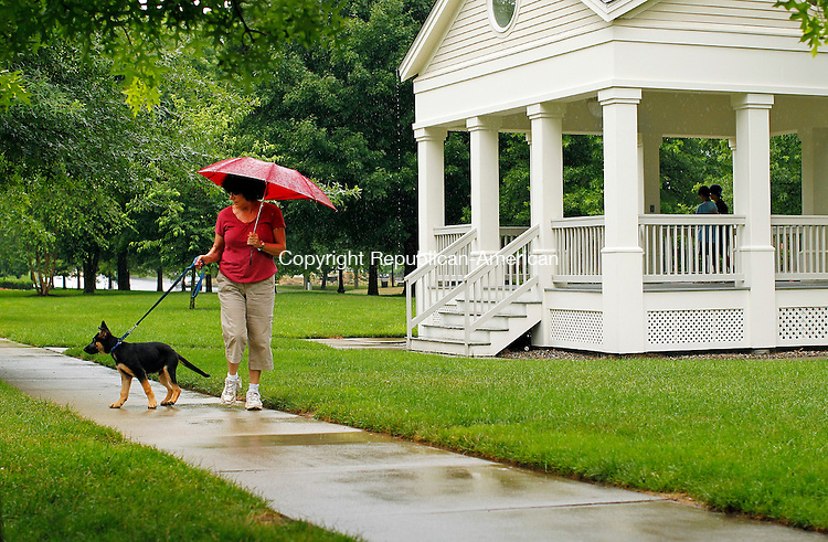 Southbury, CT-19, July 2010-071910CM03   Rain storms didn't stop this woman walking her dog along the Southbury Green Shopping Plaza Monday afternoon in Southbury.  Strong thunderstorms ripped through parts of southeastern Connecticut, dropping much needed rain into the region.  Today (Tuesday) is expected to be partly sunny with high's in the upper 80's.  --Christopher Massa Republican-American
