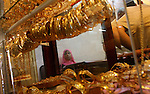 A Palestinian woman looks at gold jewellery at a jewellery store in Gaza city on 21 July 2011. A Palestinian vendor says that the one gold ounce cost 1650 US dollars at the local market which is and all time high for the market. Photo by Ashraf Amra