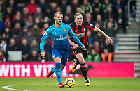 Jack Wilshere of Arsenal & Dan Gosling of AFC Bournemouth during the Premier League match between Bournemouth and Arsenal at the Goldsands Stadium, Bournemouth, England on 14 January 2018. Photo by Andy Rowland.