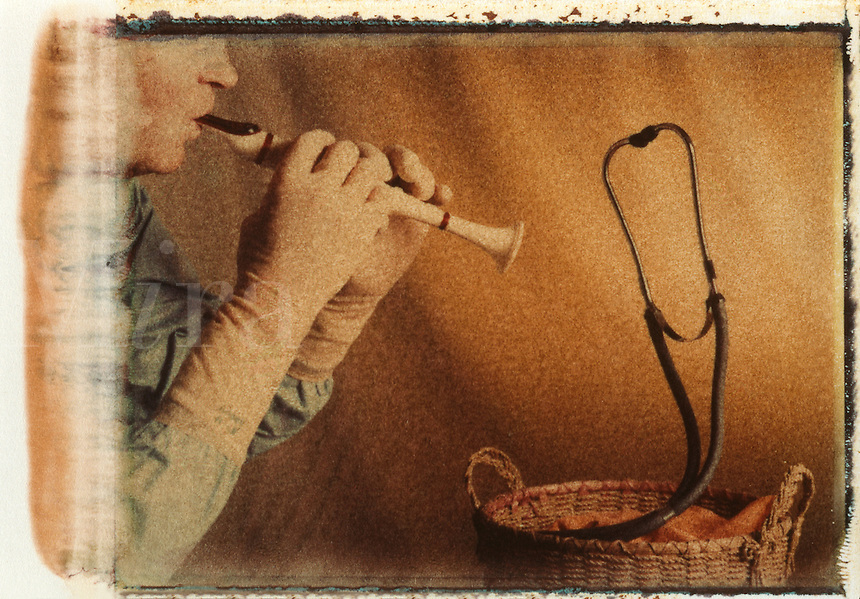 Snake charmer, medical mystery, doctor with flute, stethoscope