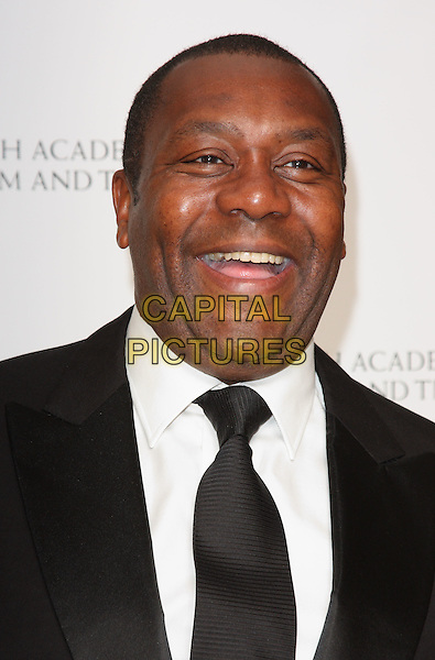 LENNY HENRY .British Academy Television Craft Awards at the Hilton, Park Lane, London, England, UK, May 23rd 2010.BAFTA portrait headshot black tie suit mouth open smiling funny .CAP/ROS.©Steve Ross/Capital Pictures