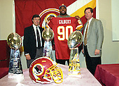 The Washington Redskins hold a press conference to announce they have traded their 1996 first round draft choice (the sixth overall) to the St. Louis Rams for Pro Bowl defensive tackle Sean Gilbert (90) at Redskins Park in Ashburn, Virginia on April 9, 1996.  From left to right: general manager Charley Casserly, Sean Gilbert, head coach Norv Turner.<br /> Credit: Arnie Sachs / CNP