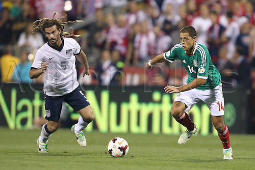 10.09.2013. Columbus, Ohio, USA. Javier Chicharito Hernandez (MEX) (14) and Kyle Beckerman (USA) (5). The United States Men's National Team played the Mexico Men's National Team at Columbus Crew Stadium in Columbus, Ohio in a CONCACAF World Cup Qualifying Final Round match for the 2014 FIFA World Cup. The U.S. won the game 2-0.