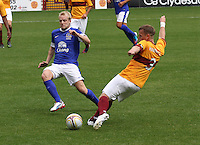 Steven Hammell crosses before being closed down by Steven Naismith in the Motherwell v Everton friendly match at Fir Park, Motherwell on 21.7.12 for Steven Hammell's Testimonial.
