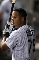 Chicago White Sox first baseman Jose Abreu (79) in the dugout during a game against the Toronto Blue Jays on August 15, 2014 at U.S. Cellular Field in Chicago, Illinois.  Chicago defeated Toronto 11-5.  (Mike Janes/Four Seam Images)