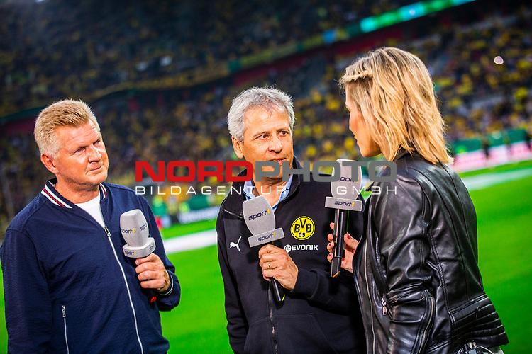 09.08.2019, Merkur Spiel-Arena, Düsseldorf, GER, DFB Pokal, 1. Hauptrunde, KFC Uerdingen vs Borussia Dortmund , DFB REGULATIONS PROHIBIT ANY USE OF PHOTOGRAPHS AS IMAGE SEQUENCES AND/OR QUASI-VIDEO<br /> <br /> im Bild | picture shows:<br /> Lucien Favre (Trainer BVB) im Interview mit Stefan Effenberg fuer Sport 1, <br /> <br /> Foto © nordphoto / Rauch