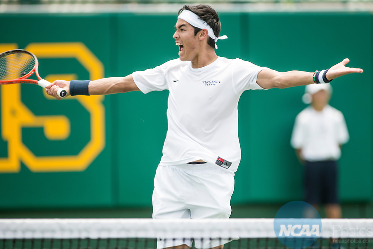 19 MAY 2015:  Thai-Son Kwiatkowski of the University of Virginia celebrates during his match at the Division I Men's Tennis Championship is held at the Hurd Tennis Center on the Baylor University campus in Waco, TX.  Virginia defeated Oklahoma 4-1 to win the team national title.  Darren Carroll/NCAA Photos