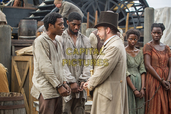 Chiwetel Ejiofor, Paul Giamatti<br /> in 12 Years a Slave (2013) <br /> *Filmstill - Editorial Use Only*<br /> CAP/FB<br /> Image supplied by Capital Pictures
