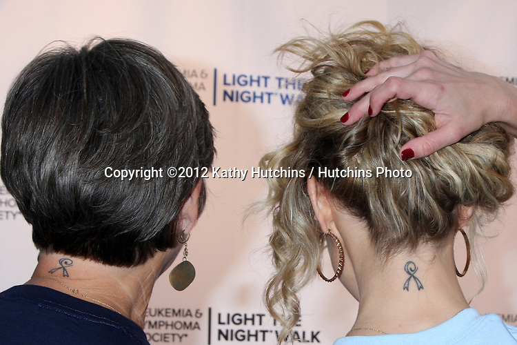 LOS ANGELES - OCT 6:  Char Griggs, Linsey Godfrey show off their cancer survivor ribbon tattoo attends the Light The Night Walk to benefit The Leukemia & Lymphoma Society at Sunset Gower Studios on October 6, 2012 in Los Angeles, CA
