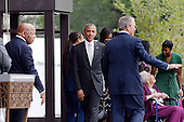 United States Representative John Lewis Democrat of Georgia), left, U.S President Barack Obama, center, and former President George W. Bush (R) share the stage with the Bonner Family during the opening ceremony of the Smithsonian National Museum of African American History and Culture on September 24, 2016 in Washington, DC. The museum is opening thirteen years after Congress and President George W. Bush authorized its construction. <br /> Credit: Olivier Douliery / Pool via CNP