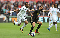 Jordan Ayew of Swansea City is challenged by Jesus Gamez of Newcastle United during the Premier League match between Swansea City and Newcastle United at The Liberty Stadium, Swansea, Wales, UK. Sunday 10 September 2017