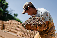 Moisés, a thirteen-year-old Salvadoran boy, carries raw clay for brick making at a brick factory in Istahua, El Salvador, 21 December 2013. Child labour is a common practice at the artisanal brick factories, found mainly in rural areas of El Salvador. Poverty and insufficient earnings in agriculture force parents to employ their own children, in an effort to ensure the livelihood for the whole family. Children aged 8-10 are allowed to work slower, with smaller volumes of clay, while children aged 12 and up work regularly, 8-10 hours a day, 6 days a week.
