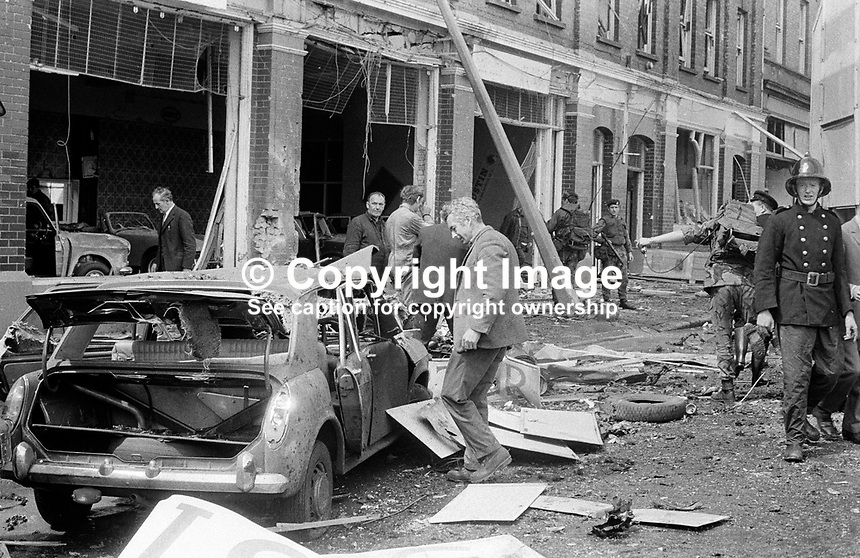 Firemen & civilians clear up after the no-warning IRA explosion in Oxford Street, Belfast, N Ireland, UK, in which one woman died and several others were seriously injured. 197205260296c..Copyright Image from Victor Patterson, 54 Dorchester Park, Belfast, UK, BT9 6RJ..Tel: +44 28 9066 1296.Mob: +44 7802 353836.Voicemail +44 20 8816 7153.Skype: victorpattersonbelfast.Email: victorpatterson@mac.com.Email: victorpatterson@ireland.com (back-up)..IMPORTANT: If you wish to use this image or any other of my images please go to www.victorpatterson.com and click on the Terms & Conditions. Then contact me by email or phone with the reference number(s) of the image(s) concerned.