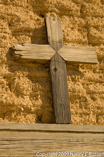 Wooden cross above church doors in Terlingua, Texas