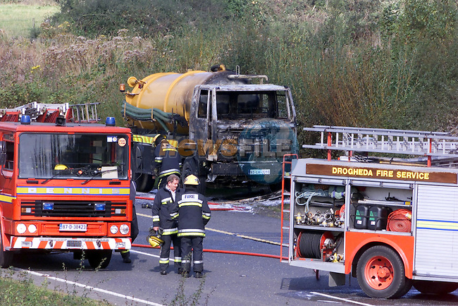 the remains of the Oil Lorry on the South Bound Carriageway of the Balbriggan By Pass..Picture Fran Caffrey Newsfile...This Picture is sent to you by:..Newsfile Ltd.The View, Millmount Abbey, Drogheda, Co Louth, Ireland..Tel: +353419871240.Fax: +353419871260.GSM: +353862500958.ISDN: +353419871010.email: pictures@newsfile.ie.www.newsfile.ie