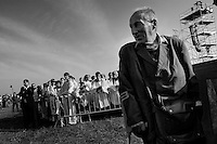 An old Czech catholic follower on crutches watches the open-air mass served by the Pope Benedict XVI in Stara Boleslav, one of the main pilgrimage site of the Czech Republic, September 28, 2009.