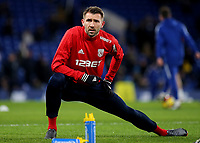 Gareth McAuley of West Brom and Northern Ireland warms up ahead of kick-off during Chelsea vs West Bromwich Albion, Premier League Football at Stamford Bridge on 12th February 2018