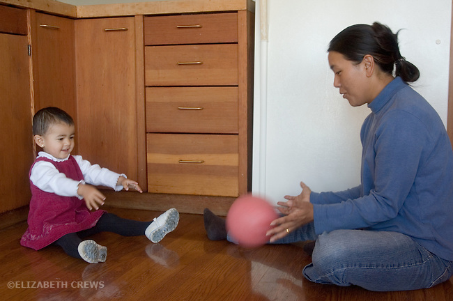 Berkeley CA Nepalese mother playing ball game with daughter, nineteen-months-old  MR