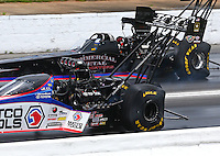 May 19, 2014; Commerce, GA, USA; View of tire distortion to the rear Goodyear tires on the cars of NHRA top fuel driver Antron Brown (near lane) and Pat Dakin as they cross the finish line during the Southern Nationals at Atlanta Dragway. Mandatory Credit: Mark J. Rebilas-USA TODAY Sports