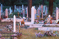 A graveyard with many recent tombs from the war with white tombstones. Evening light. Town of Mostar. Federation Bosne i Hercegovine. Bosnia Herzegovina, Europe.