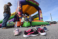 Kids leave their shoes on the walk to play Saturday Feb. 8 2020 in a bounce house at the 8th Street Gateway Park community input event in Bentonville. Go to nwaonline.com/200209Daily/ to see more photos.<br />