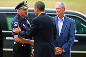 United State President Barack Obama (C) is greeted by Aurora Police Chief Dan Oates (L) and Aurora Mayor Steve Hogan after arriving at Buckley Air Force Base July 22, 2012 in Aurora, Colorado. Obama traveled to the University of Colorado Hospital to meet with victims of last Friday's movie theater mass shooting. Police in Aurora, a suburb of Denver, say that James Holmes, 24, in custody after he is suspected of killing 12 people and injuring 59 during a midnight screening of 'The Dark Knight Rises' last Friday. .Credit: Chip Somodevilla / Pool via CNP