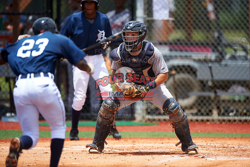 GCL Tigers West catcher Andres Sthormes (9) waits for a throw as Alexis Garcia (23) runs home during a game against the GCL Tigers East on August 4, 2016 at Tigertown in Lakeland, Florida.  GCL Tigers West defeated GCL Tigers East 7-3.  (Mike Janes/Four Seam Images)