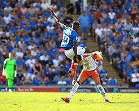 Jamal Lowe of Portsmouth lands on the back of Dan Potts of Luton Town during Portsmouth vs Luton Town, Sky Bet EFL League 1 Football at Fratton Park on 4th August 2018