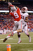 Ohio State Buckeyes wide receiver Devin Smith (9) catches a 42-yard touchdown pass behind Wisconsin Badgers cornerback Peniel Jean (21) during the third quarter of the Big Ten Championship game at Lucas Oil Stadium in Indianapolis on Dec. 6, 2014. (Adam Cairns / The Columbus Dispatch)